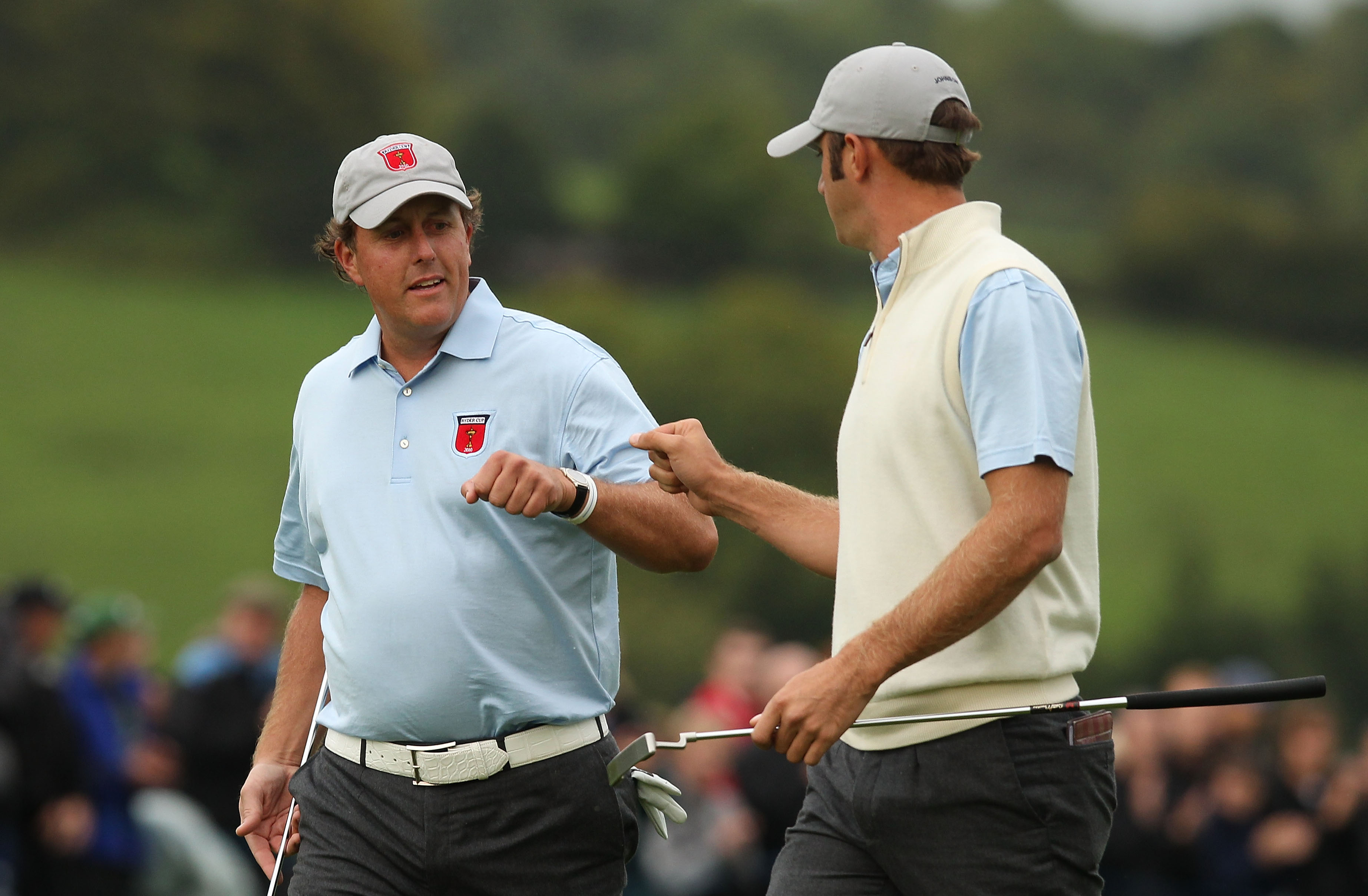 NEWPORT, WALES - OCTOBER 01:  Phil Mickelson of the USA celebrates a birdie putt on the 7th green with Dustin Johnson (R) during the Morning Fourball Matches during the 2010 Ryder Cup at the Celtic Manor Resort on October 1, 2010 in Newport, Wales.  (Photo by Ross Kinnaird/Getty Images)