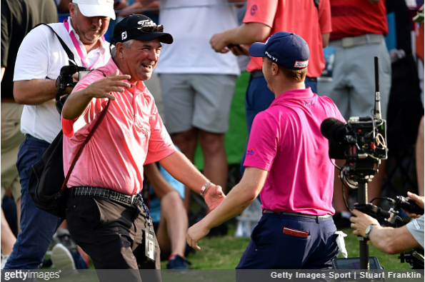Justin Thomas and his father celebrate.